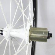 closeup of rear blade hub – white hub, white spokes